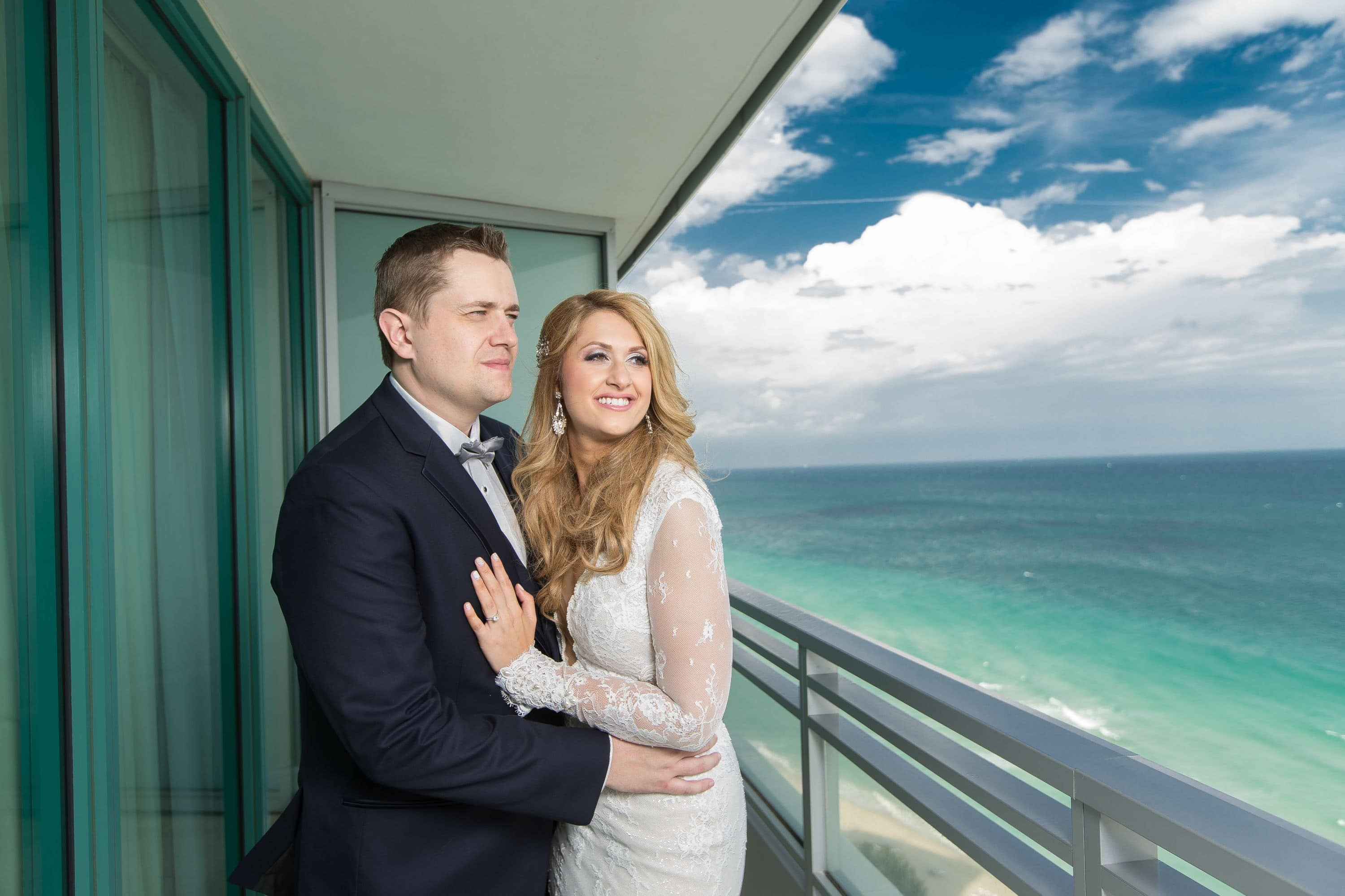Bride and groom during a Diplomat Beach Resort Wedding take a moment to admire the view