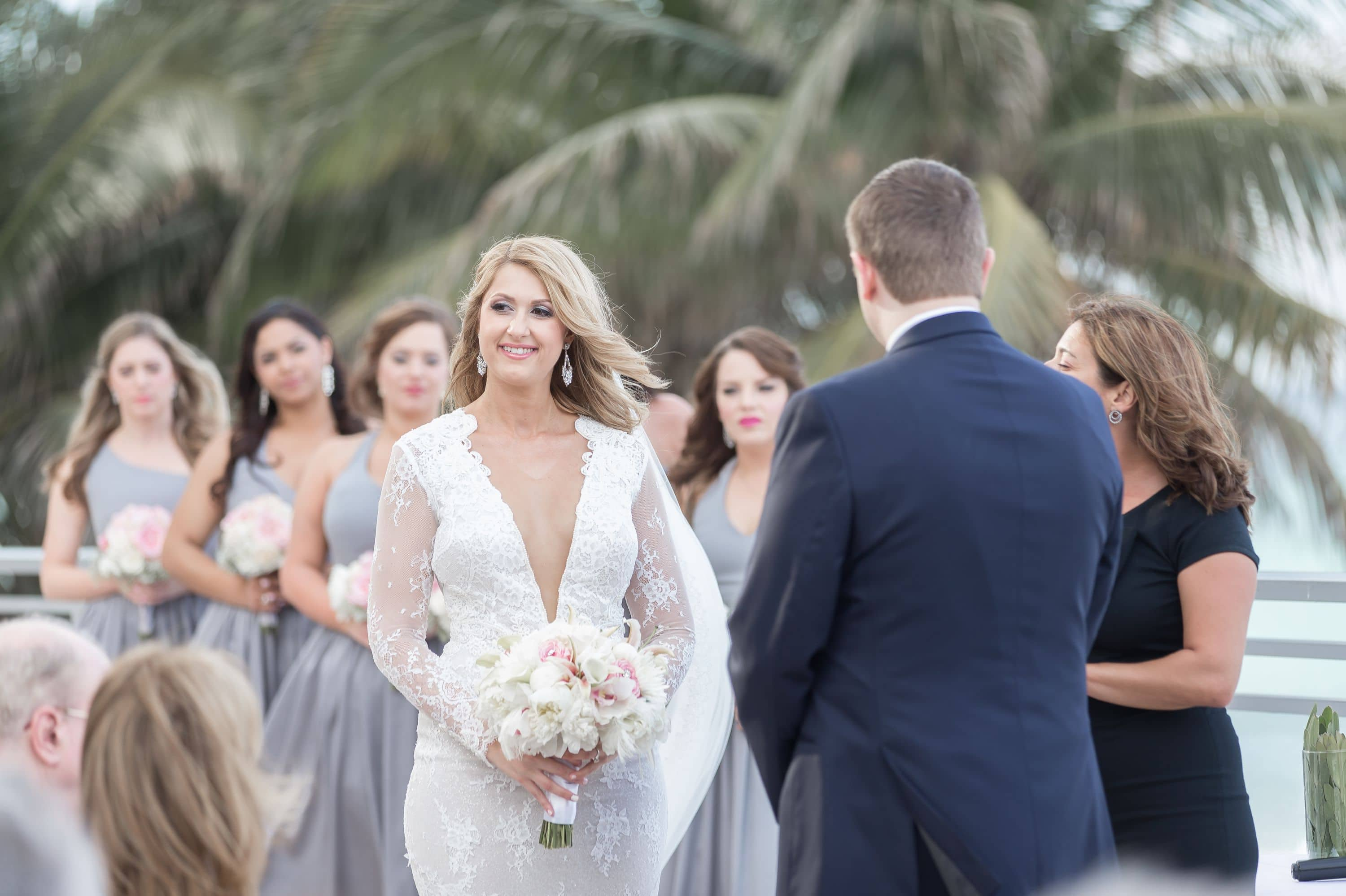 Some candid shots of the bride during the ceremony at this Diplomat Beach Resort Wedding