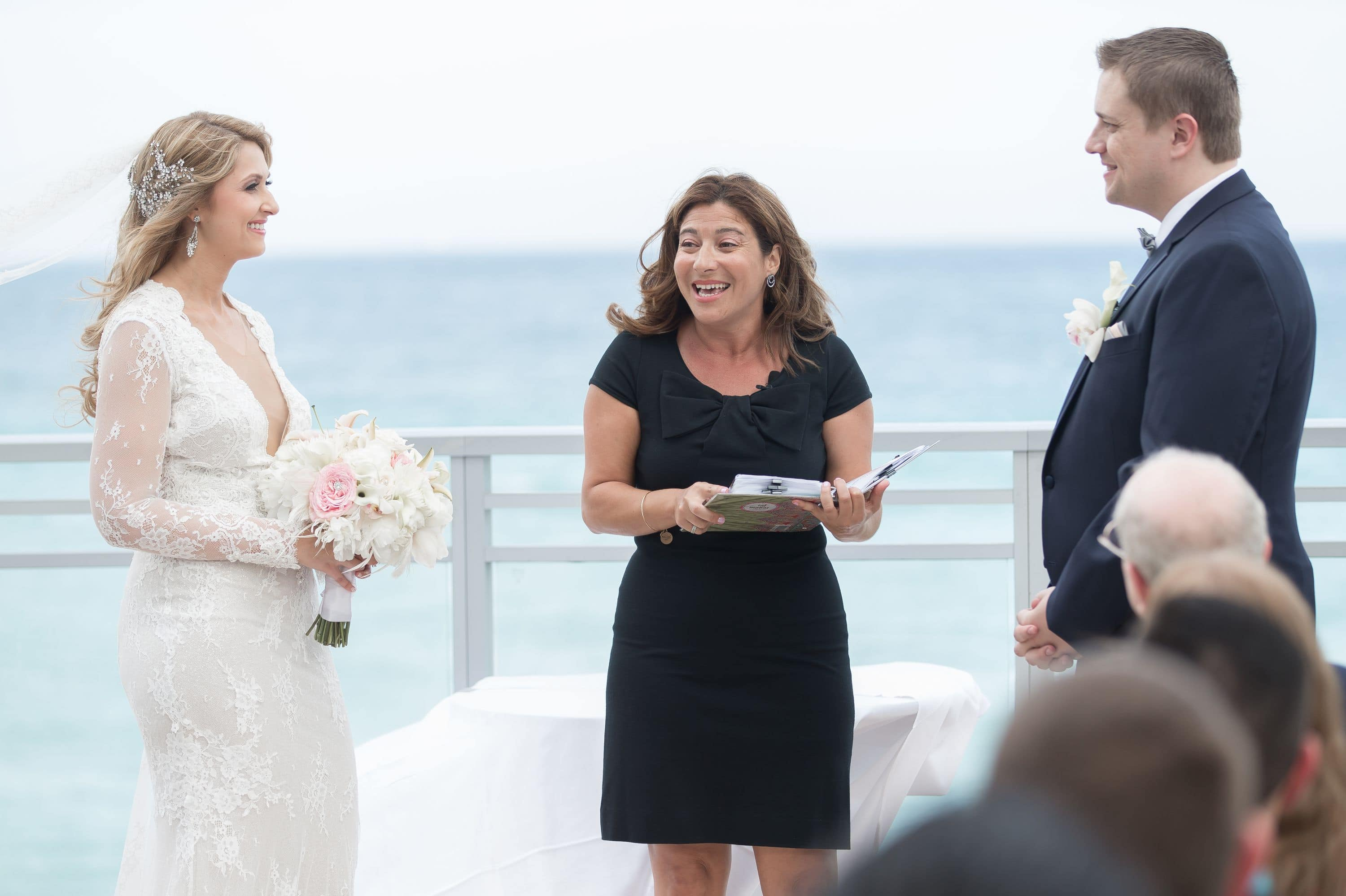 A photo showing bride and groom with the ocean view at this Diplomat Beach Resort Wedding