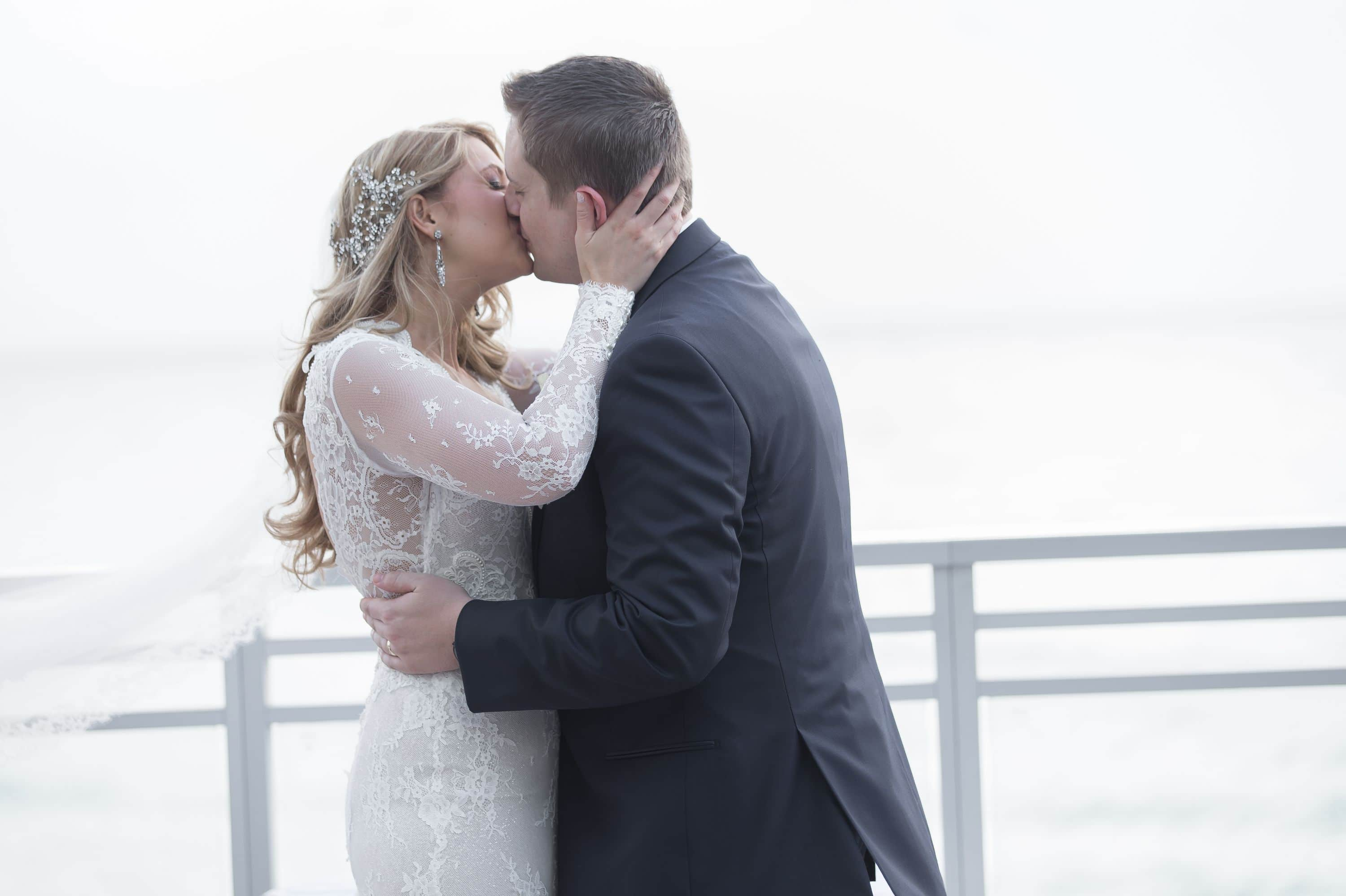 After this Diplomat Beach Resort Wedding the bride and groom kiss