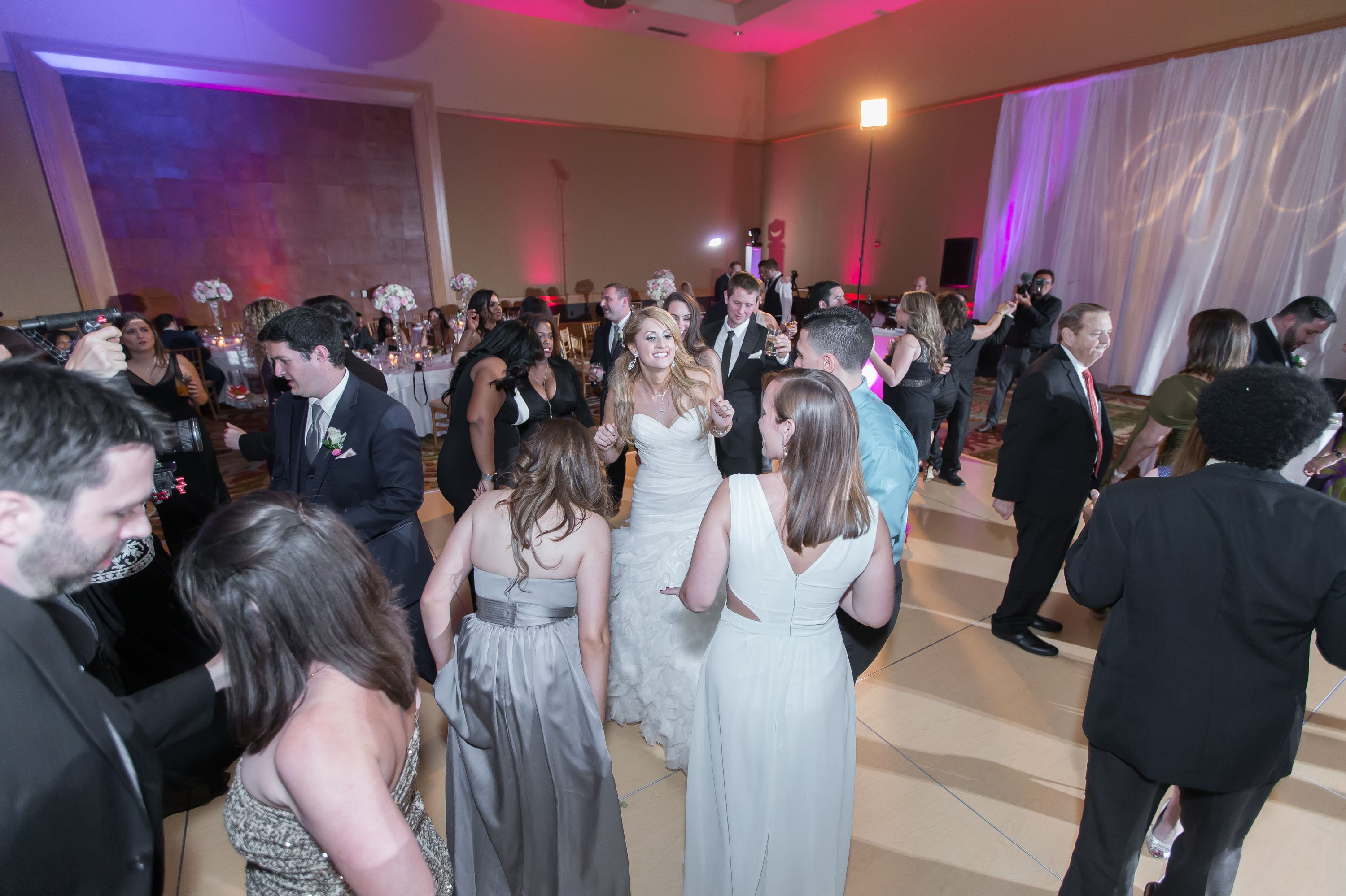 Candid dance floor photo at this Diplomat Beach Resort Wedding